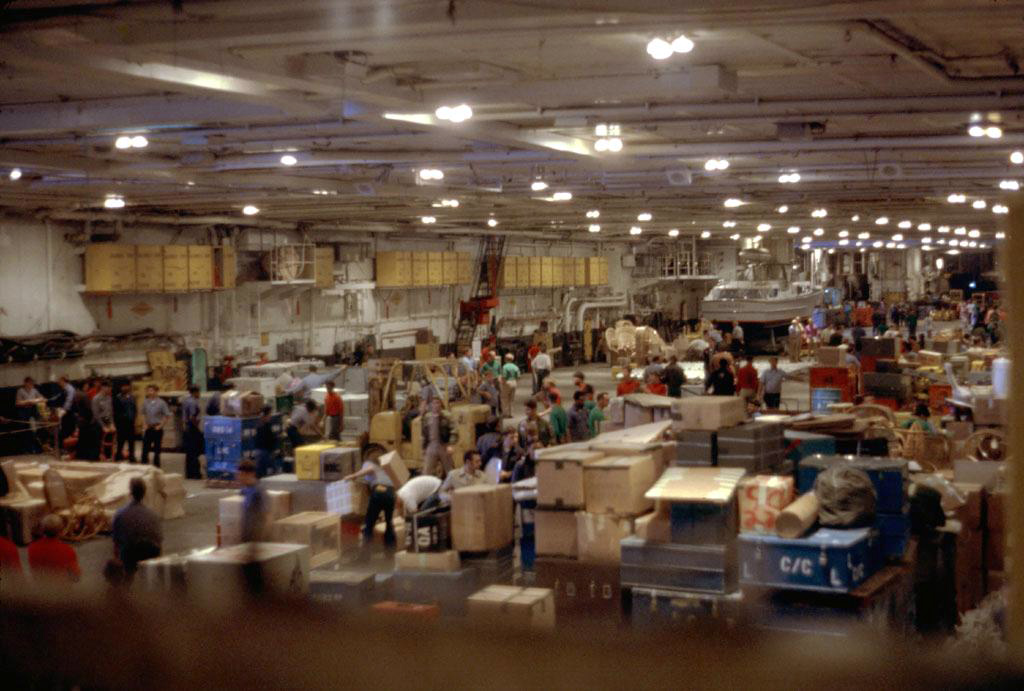 ' ' from the web at 'http://www.usscoralsea.net/images/cv4319771004-35-hanger_bay_storage.jpg'