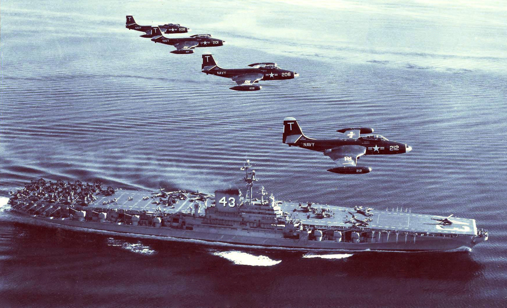 'Hi Resolution Photo Click Here' from the web at 'http://www.usscoralsea.net/images/cvb4321jun1951VF-12F2H-2color.jpg'