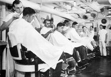 '[USS CORAL SEA TRIBUTE SITE]' from the web at 'http://www.usscoralsea.net/images/vtn_web_cvb431952barbershop.jpg'